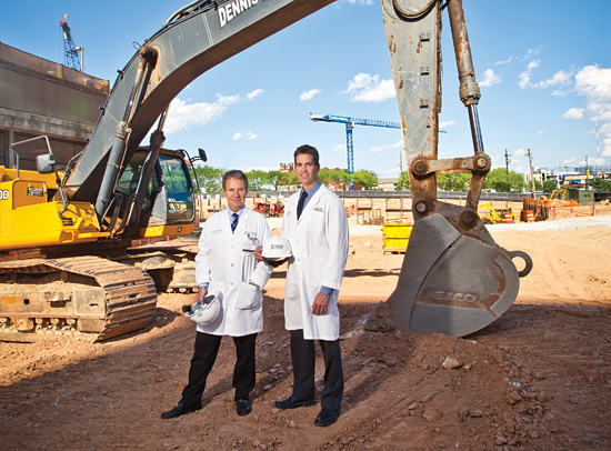 Radiation oncologists Ian Crocker and Tim Fox at the future site of the Emory Proton Therapy Center in Atlanta.